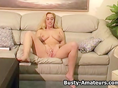 Busty amateur Cheri masturbates her pussy with toy