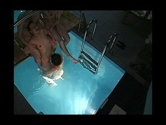 Naked skinny dipping in a pool