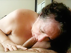 Brunette grandma sucking a young shaft