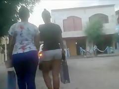Hidden camera follows two sexy girls in tight clothes walki