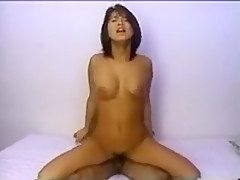 Bodacious Oriental beauty takes a throbbing dick for a ride