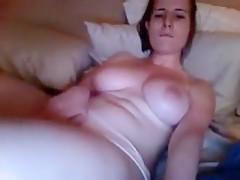 Woman masturbating to adult
