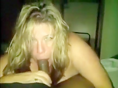 Slutty blonde sucks on dick that is black