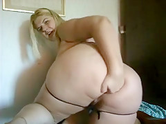 Fat woman moves ATM with fingertips