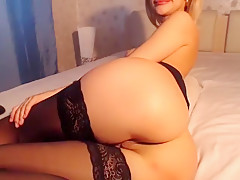 Busty blonde in black stockings fingers her hairless cunt o