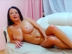 Busty brunette on cam influencing and stripteasing with h