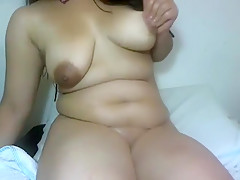 Busty Latina shows her boobs and sucks on a vibrator on liv