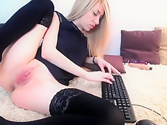 Luscious blonde buries a toy in her ass and fingers her sha