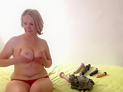 Mature blonde with saggy tits fingers her snatch on live ca
