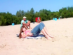 Real beach nudist voyeur pussies stretching on the sand