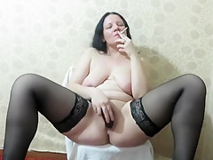 Brunette Smokes And Masturbates
