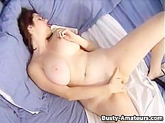 Busty Kathryns playing her pussy while on phone