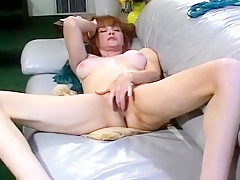 Redhead Milf Working at Her Playful Cooter