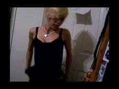 """A teen blone strips off her """"little black dress"""""""