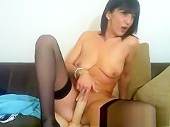 Hot brunette milf toys her wet snatch in hd