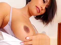 Sexy russian brunette with big boobs oils her