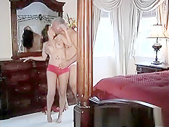 A MILf in lingerie is touching sing her own boobs
