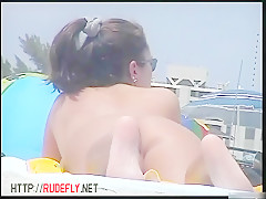 Naked bodies, naked boobs and pussy in this nude beach video 4