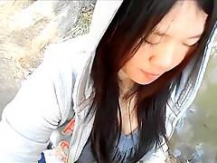 Petite Asian Blows Cock in a Park