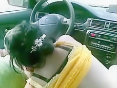 Brunette hooker gives client a blowjob in his car and swallows cum