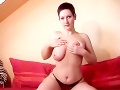 Short haired webcaamateur with big tits rubs oil on her body