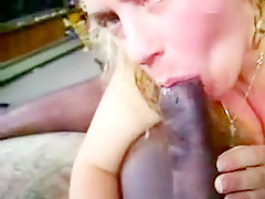 Energetic blonde getting her throat roughly fucked by a huge black cock