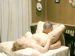 Buxom mature wife enjoying cunnilingus on dining table