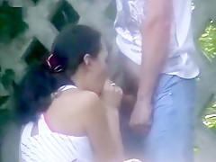 Slutty amateur brunette giving her man an incredible blowjob downtown