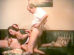 Smoking hot cuckold wifey taking care of two hard cocks all at once