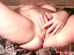 Pale chubby wife plays with her shaved nookie on the bed