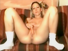 Sexy blonde with tattoos masturbates on the couch