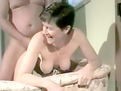 Sexy short haired brunette milf in corset gets rammed doggystyle pant and moan