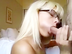 Tanned blonde babe gets facialized after sucking dick and giving titjob