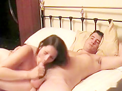 This tasty brunette gobbles up hubby's dick like a pro before he pumps her full of cum