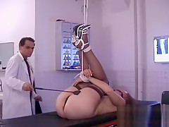 Slutty doxy gets her ass slapped red while being bounded