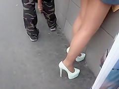 Brunette enjoys foot fetish outdoor