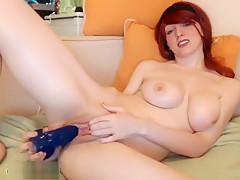 Redhead Rides A Huge Dildo