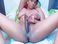 Black Chick Is Licking Her Tits