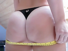 Busty Chick Measures Her Ass