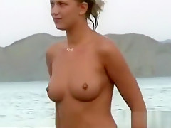 Exibitionist woman getting nude about the beach