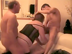 MILF woman gets two cocks in the same period