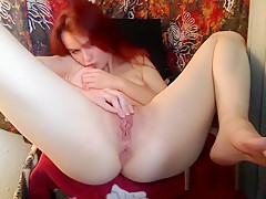 Nice Hard Bodied Redhead Falls Her Dildo Inside Her Pussy