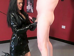 Clothed domina jerks cock