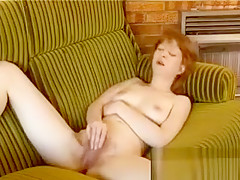 Horny Redhead Rubbing Her Hairy Pussy