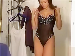 Beautiful Mother Putting On Lingerie