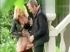 Dude spies on chick sucking in garden