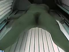 Hot blonde temptress tans her adorable body in solarium