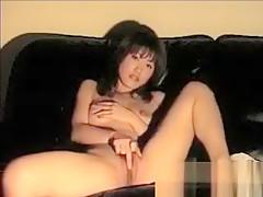 Busty asian babe masturbating on sofa