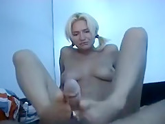 A Footjob Is Given By Blonde Milf In Pigtails