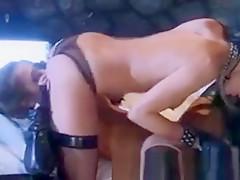 Lesbians in latex enjoying dildo time